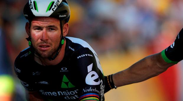 Mark Cavendish crosses the finish line after he crashed during the sprint of the fourth stage of the Tour de France