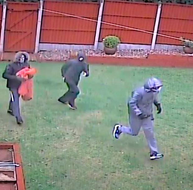Undated handout CCTV still issued by Nottinghamshire Police of three masked burglars who frightened residents out of their home after smashing their way into the rear of an address in Nottingham. Photo: Nottinghamshire Police/PA Wire