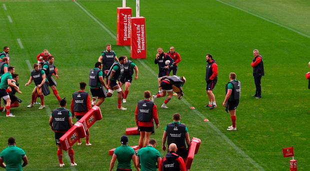The Lions warm up during a training session at QBE Stadium in Auckland today
