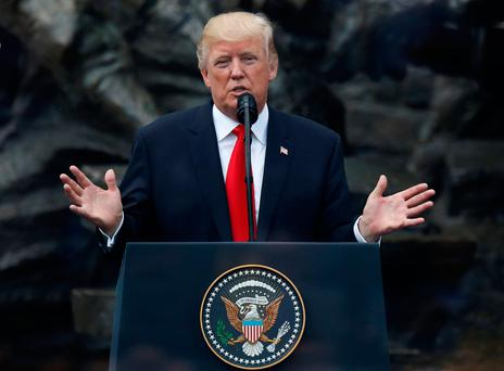 U.S. President Donald Trump gestures as he gives a public speech at Krasinski Square in Warsaw, Poland July 6, 2017. REUTERS/Kacper Pempel