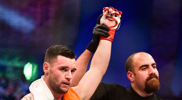 16 December 2016; Kiefer Crosbie celebrates defeating Conor Riordan in their welterweight bout at BAMMA 27 in the 3 Arena in Dublin. Photo by Ramsey Cardy/Sportsfile