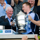 Dublin captain Johnny McCaffrey is presented with the Bob O'Keeffe Cup in 2013 by Jimmy Gray