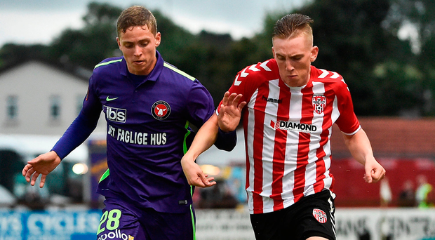 Ronan Curtis of Derry City in action against Andre Remer of Midtjylland. Photo: Sportsfile