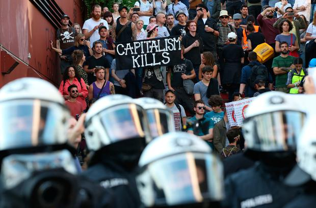 Police officers in operation during a protest against the upcoming G20 summit in Hamburg, Germany, Thursday July 6, 2017. The leaders of industrialised nations, G20, are holding a two day summit starting Friday in Hamburg. ( Bodo Marks/dpa via AP)
