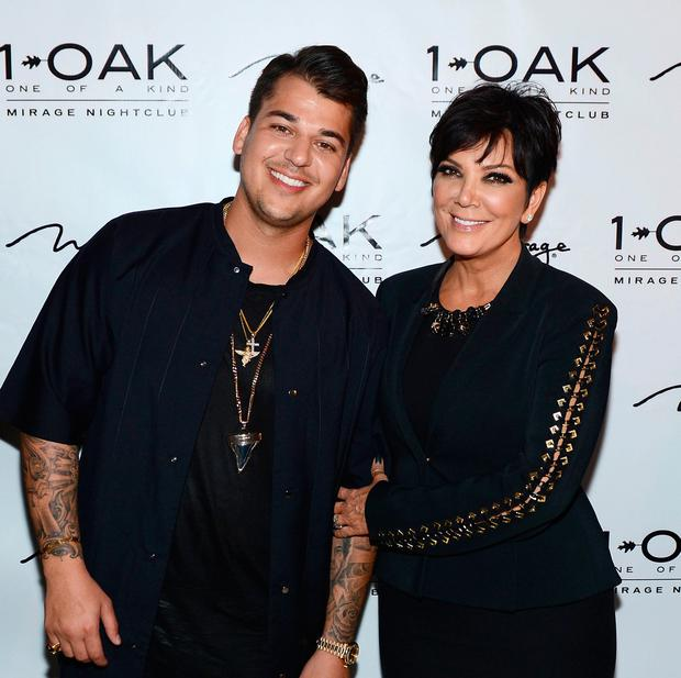 Rob Kardashian and Kris Jenner arrive at Rob Kardashian's 26th birthday celebration at 1 OAK Nightclub at The Mirage Hotel & Casino on March 15, 2013 in Las Vegas, Nevada. (Photo by Denise Truscello/WireImage)