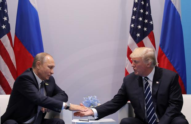U.S. President Donald Trump shakes hands with Russian President Vladimir Putin during their bilateral meeting at the G20 summit in Hamburg, Germany July 7, 2017. REUTERS/Carlos Barria
