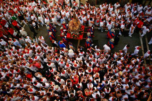 A figure depicting as Saint Fermin is carried by people along the street, during a procession at the San Fermin Festival, in Pamplona, northern Spain, Friday, July 7, 2017. (AP Photo/Alvaro Barrientos)