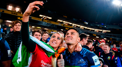 Lions supporter Roisin Mullan, from Myshall, Co Carlow, takes a photograph with Sonny Bill Williams after the Auckland Blues victory against the tourists at Eden Park. Photo by Stephen McCarthy/Sportsfile
