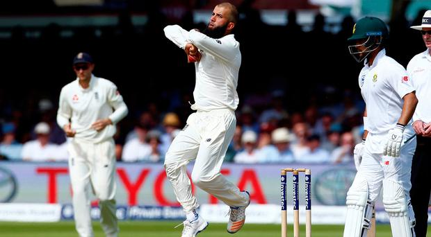 Moeen became the seventh England all-rounder to achieve the 2,000 runs/100 wickets double. Photo: Reuters/Peter Cziborra