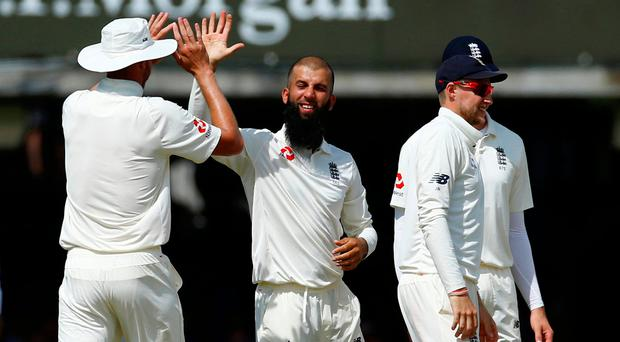 England spinner Moeen Ali celebrates taking the wicket of South Africa's Hashim Amla. Photo: Reuters/Peter Cziborra