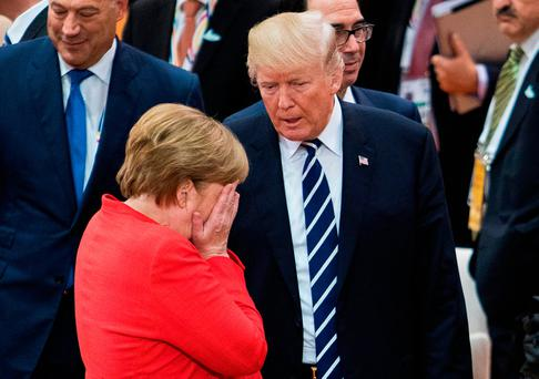 German Chancellor Angela Merkel, front, talks with U.S. President Donald Trump prior to the first working session on the first day of the G-20 summit in Hamburg, northern Germany, Friday, July 7, 2017. The leaders of the group of 20 meet July 7 and 8. (Tore Meek/NTB Scanpix via AP)