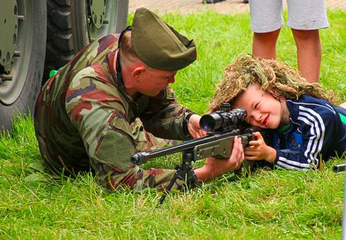 A child gets to grips with a rifle at last year's Farmleigh Open Day