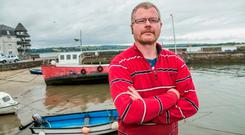 Richard Satchwell, husband of missing Tina Satchwell, in Youghal Harbour near their home on Grattan Street. Photo: Kyran O'Brien