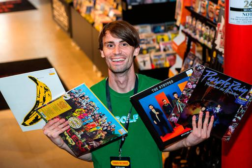Cillian Grant of Tower Records with a selection of records on sale in the Dawson Street store. Photo: Doug O'Connor