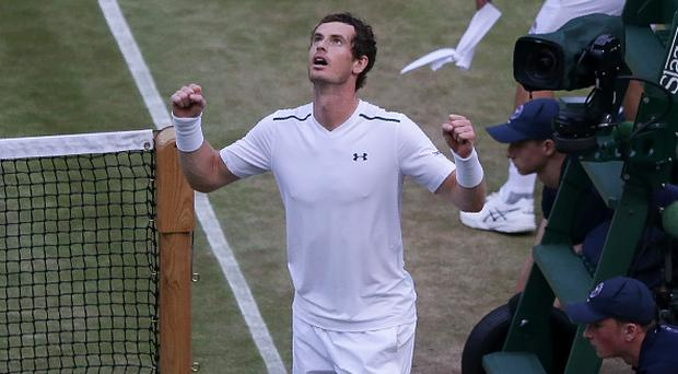 Britain's Andy Murray celebrates beating Italy's Fabio Fognini during their men's singles third round match on the fifth day of the 2017 Wimbledon Championships at The All England Lawn Tennis Club in Wimbledon, southwest London, on July 7, 2017. / AFP PHOTO / Daniel LEAL-OLIVAS / RESTRICTED TO EDITORIAL USE
