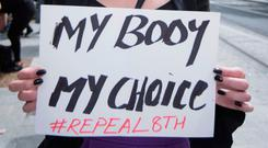 A pro-choice protester at the annual 'Rally for Life' march last Saturday. Photo: Fergal Phillips