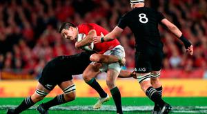 British and Irish Lions' Johnny Sexton is tackled by New Zealand's Jerome Kaino