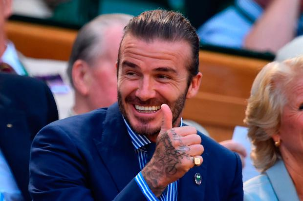 Former England footballer David Beckham gestures as he sits in the Royal Box on Centre Court on the fifth day of the 2017 Wimbledon Championships at The All England Lawn Tennis Club in Wimbledon southwest London