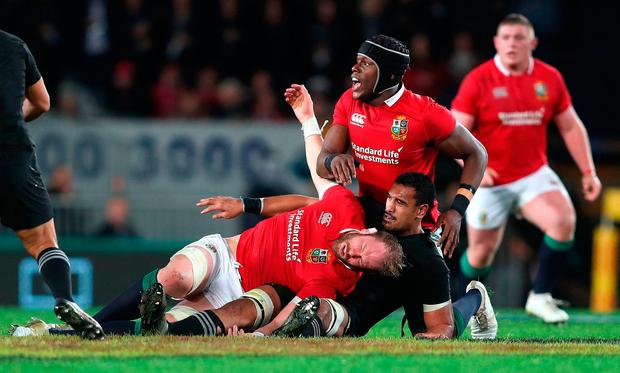 British and Irish Lions' Alun Wyn Jones is tackled by New Zealand's Jerome Kaino