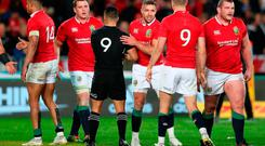 New Zealand's Aaron Smith shakes hands with British and Irish Lions' Rhys Webb