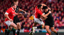 Codie Taylor of New Zealand is tackled by Conor Murray