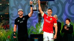 British and Irish Lions' Sam Warburton and New Zealand's Kieran Read lift the Series Trophy