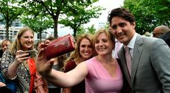 Say cheese: Justin Trudeau poses for a selfie in Dublin. Photo: Clodagh Kilcoyne