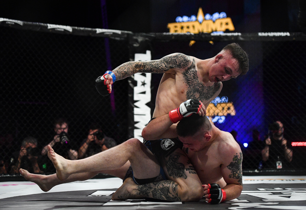Rhys McKee, left, in action against Richie Smullen during their lightweight bout at BAMMA 30 at the 3 Arena in Dublin. Photo by Ramsey Cardy/Sportsfile