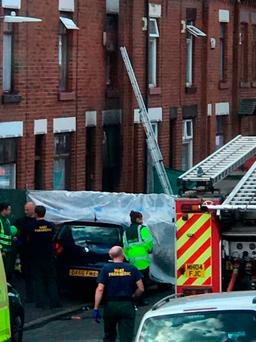 Handout photo taken with permission from the Twitter feed of Aymen Mohamed @aymenbolton of emergency services at the scene of a blaze in Rosamond Street in Bolton where three children and a woman have died Credit: Aymen Mohamed/PA Wire