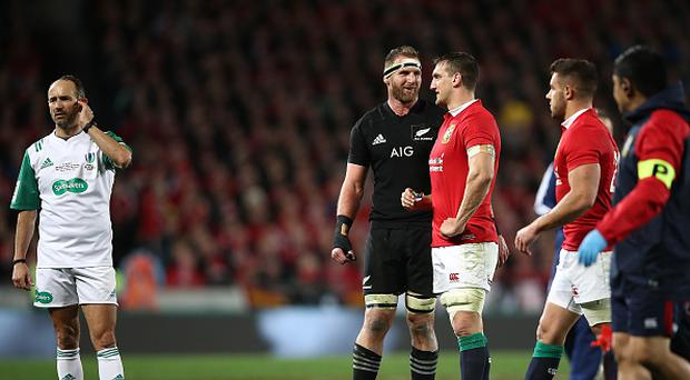 Referee Romain Poite stands next to All Black captain Kieran Read and Lions captain Sam Warburton as he downgrades a call made in the final minutes from a penalty to a scrum during the Test match between the New Zealand All Blacks and the British & Irish Lions at Eden Park on July 8, 2017 in Auckland, New Zealand. (Photo by Phil Walter/Getty Images)