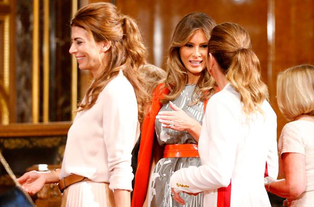 U.S. First Lady Melania Trump, center, talks to Canadian Prime Minister's wife Sophie Gregoire-Trudeau, right, during a spouses program of the G-20 summit at the town hall in Hamburg, Germany, Saturday, July 8, 2017. (Axel Schmidt/Pool Photo via AP)