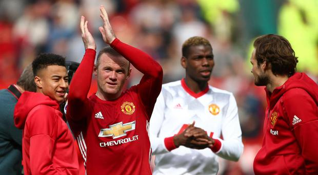 Wayne Rooney has told his teammates that he is moving back to Everton Getty