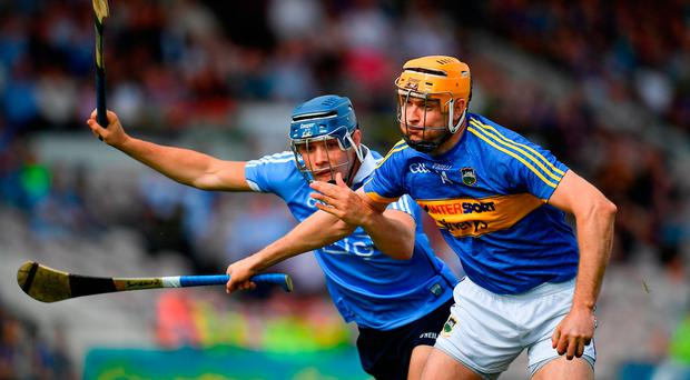 Seamus Callanan of Tipperary in action against Eoghan O'Donnell of Dublin