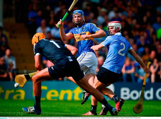 John McGrath of Tipperary scores his side's second goal past Dublin goalkeeper Conor Dooley and Cian O'Callaghan