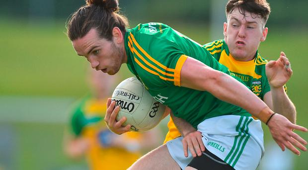 Cillian O'Sullivan of Meath in action against Kieran Gillespie of Donegal