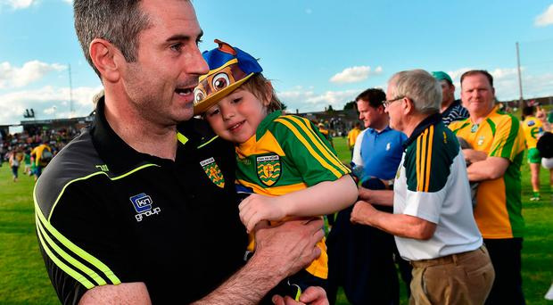 Donegal manager Rory Gallagher celebrates with his son Seanie, age 3