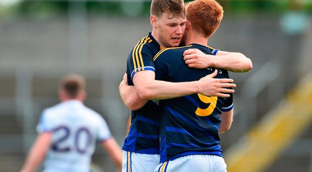 Liam Casey, left, and George Hannigan of Tipperary celebrate at the end
