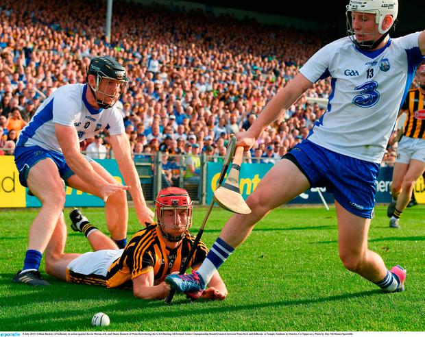 Cillian Buckley of Kilkenny in action against Kevin Moran, left, and Shane Bennett of Waterford during the GAA Hurling All-Ireland Senior Championship Round 2 match between Waterford and Kilkenny at Semple Stadium in Thurles, Co Tipperary. Photo by Ray McManus/Sportsfile