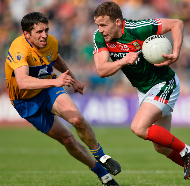 Andy Moran of Mayo in action against Gordon Kelly of Clare. Photo: Sportsfile