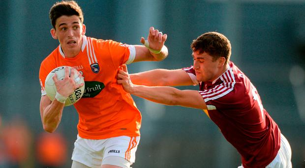 Rory Grugan of Armagh in action against Kelvin Reilly of Westmeath