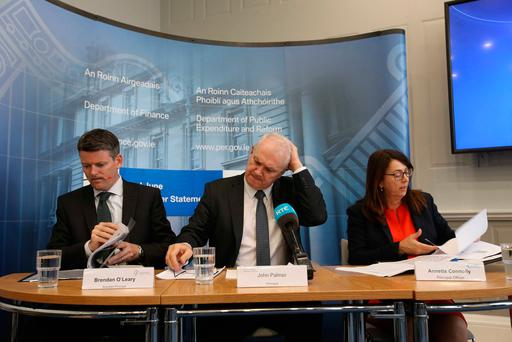 Measure of the economy: Assistant Principal Officer Brendan O'Leary (left), and Principal Officers John Palmer and Annette Connolly at the Department of Finance press conference to release the Exchequer returns for the second quarter Photo: Sam Boal