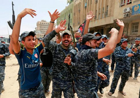 Iraqi Federal Police celebrate in the Old City of Mosul Photo: REUTERS/Ahmed Saad