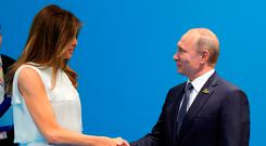 Lady's first: Russia's president Putin greets Melania Trump before his talks with her husband Photo: Mikhail Klimentyev, Kremlin Pool Photo via AP