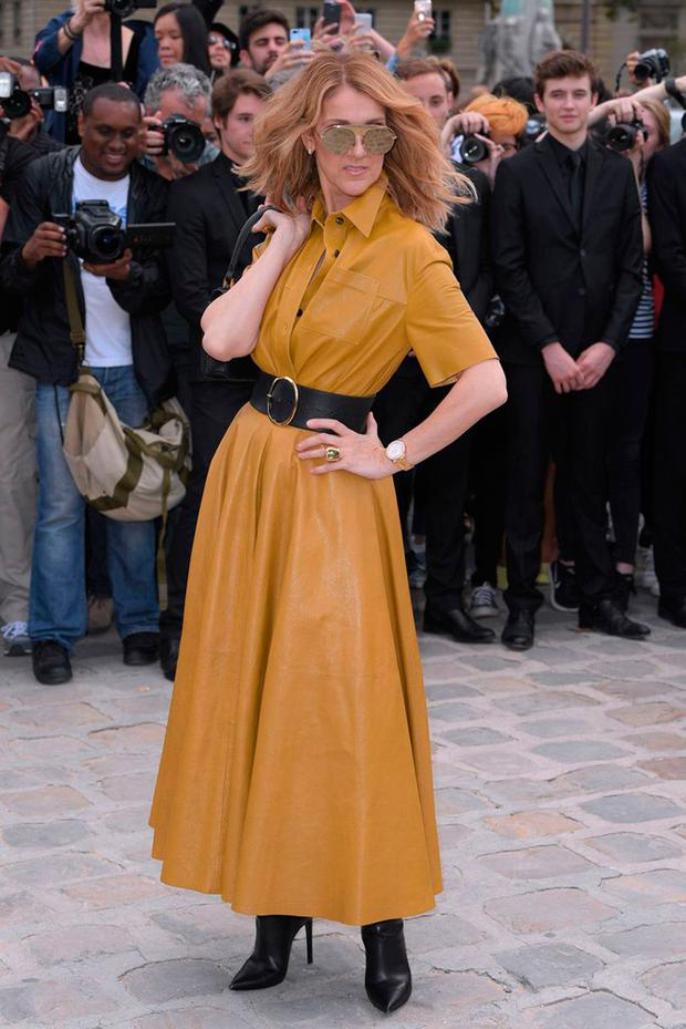 In a mustard leather dress by Dior
