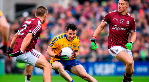 Ciaran Murtagh of Roscommon in action against Cathal Sweeney, left and Eamonn Brannigan of Galway