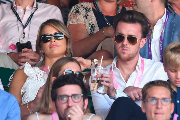 Vogue Williams and a guest attend day six of the Wimbledon Tennis Championships at the All England Lawn Tennis and Croquet Club on July 8, 2017 in London, United Kingdom. (Photo by Karwai Tang/WireImage)