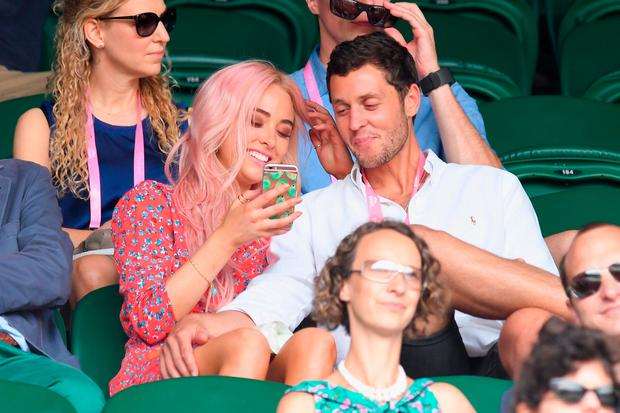Nicola Hughes and a guest attend Wimbledon as evian guests during day 6 on July 8, 2017 in London, England. (Photo by Karwai Tang/Getty Images for evian)