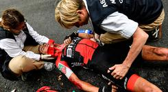 Australia's Richie Porte receives medical assistance after crashing with Dan Martin