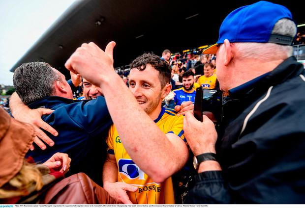9 July 2017; Roscommon captain Ciaran Murtagh is congratulated by supporters following their victory in the Connacht GAA Football Senior Championship Final match between Galway and Roscommon at Pearse Stadium in Galway. Photo by Ramsey Cardy/Sportsfile