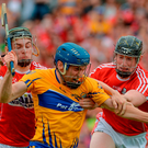Shane O'Donnell of Clare is fouled for a penalty by Mark Coleman, left, and Damien Cahalane of Cork